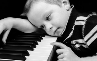 Child learning piano